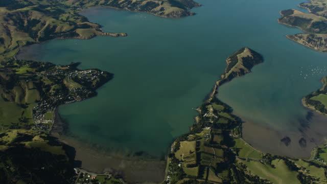 tilt-up shot of the akaroa harbor - akaroa stock videos & royalty-free footage