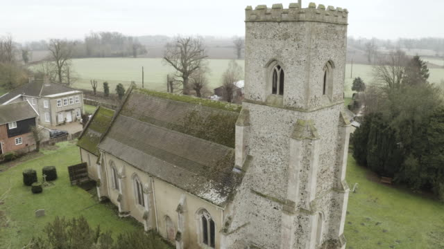 tilt-up shot of the church of st mary in troston - veranda stock videos & royalty-free footage