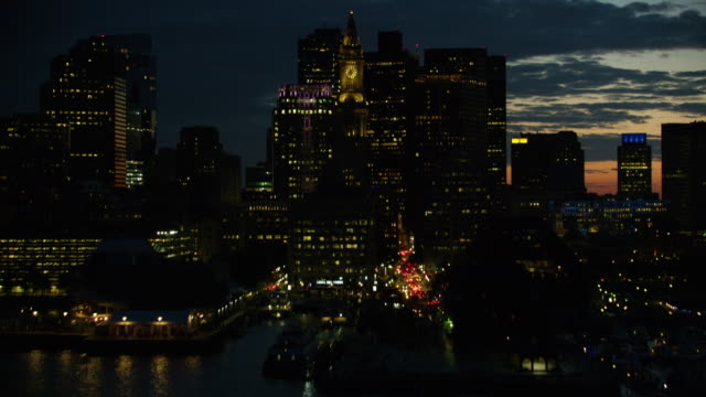 tilt-up shot of the custom house in downtown boston at night - sailing boat stock videos & royalty-free footage