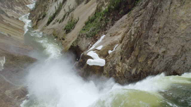 tilt-up shot of the lower falls and the grand canyon of yellowstone - river yellowstone stock videos & royalty-free footage