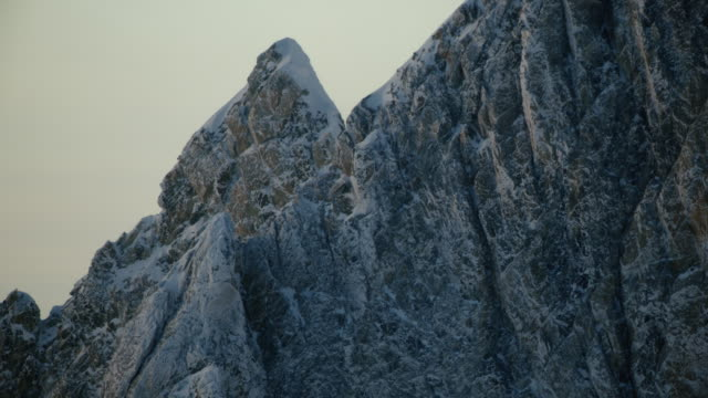 tilt-up shot of the peak of the middle teton - deep snow stock videos & royalty-free footage