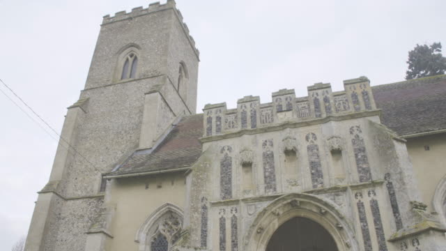 tilt-up shot of the porch of the church of st mary the virgin in troston - ornate stock videos & royalty-free footage