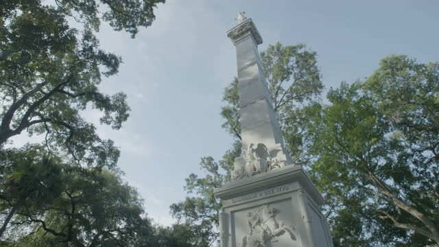 tilt-up shot of the pulaski monument in monterey square - female likeness stock videos & royalty-free footage
