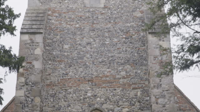 tilt-up shot of the st martins church in canterbury - stone object stock videos & royalty-free footage