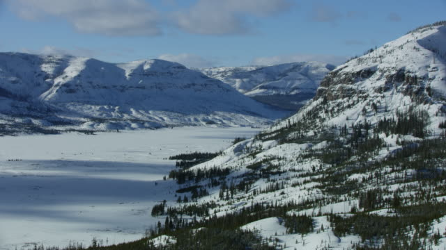 tilt-up shot of the thorofare valley in winter - wyoming stock videos & royalty-free footage