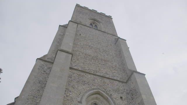 tilt-up shot of the tower of the church of st mary in troston - tomb stock videos & royalty-free footage