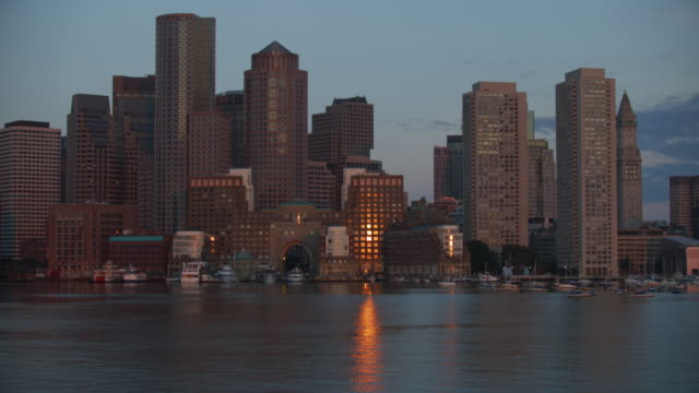 tilt-up shot of the waterfront at sunrise - custom house tower stock videos & royalty-free footage