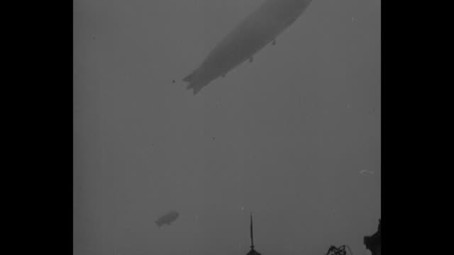 Tiltup shot several airships over Pres Herbert Hoover's inauguration / POV from camera plane of airships in flight / aerial POV from airship of the...