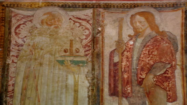 tilt-up to a fresco of saint maron and saint rocco at the church of saint maron in volperino. during the crusades the relics of saint maron, founder... - the crusades stock videos & royalty-free footage