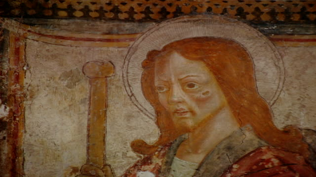 tilt-up to a fresco of saint rocco at the church of saint maron in volperino. during the crusades the relics of saint maron, founder of the maronite... - the crusades stock videos & royalty-free footage