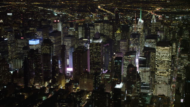 tilt-up to look over midtown manhattan at night. shot in 2011. - artbeats stock videos & royalty-free footage
