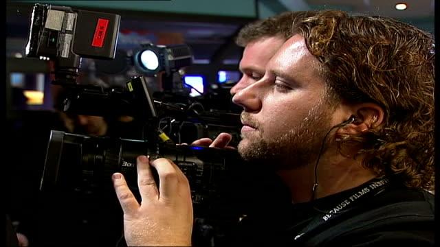 tim burton and helena bonham carter attend 3d screening of the nightmare before xmas at the london film festival camera operator focusing / more of... - flüssigkristallanzeige stock-videos und b-roll-filmmaterial