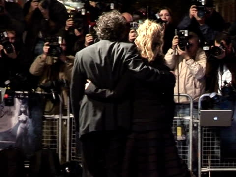 Tim Burton and Helena Bonham Carter being photographed by the press at the 'Corpse Bride' London Premiere on October 17 2005