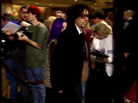 Tim Burton with model Lisa Marie signing fan autographs and walking down red carpet