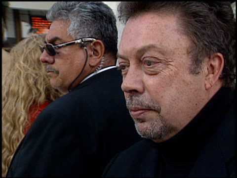 vídeos de stock e filmes b-roll de tim curry at the premiere of 'the wild thornberrys' at the cinerama dome at arclight cinemas in hollywood california on december 8 2002 - cinerama dome hollywood