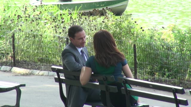 tim dekay and tiffani thiessen on location for 'white collar' in central park in new york ny on 8/27/13 - tiffani thiessen stock videos & royalty-free footage