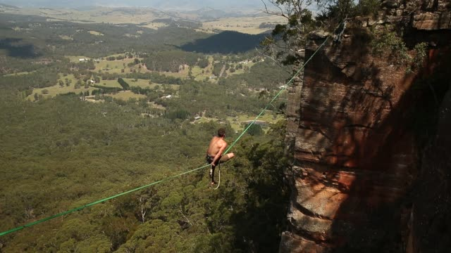 Tim Desmond of Australia balances on a highline rigged between cliffs at Corroboree Walls in Mount Victoria on March 8 2015 in the Blue Mountains...