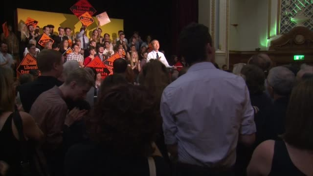 tim farron elected leader of the liberal democrats england london photography** tim farron mp applauded by audience as onto stage at victory rally... - 英自由民主党点の映像素材/bロール