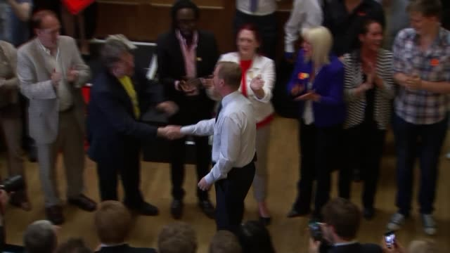 tim farron elected leader of the liberal democrats high angle shot of tim farron shaking hands with supporters at victory rally and hugging former... - 英自由民主党点の映像素材/bロール