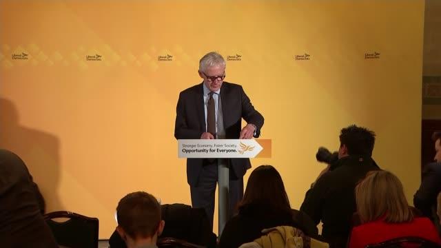 tim farron elected leader of the liberal democrats r31031502 3132015 int norman lamb mp along to speak at podium - 英自由民主党点の映像素材/bロール