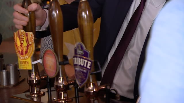 tim farron pouring a pint at a pub in st albans during the campaign trail - organised group stock videos & royalty-free footage