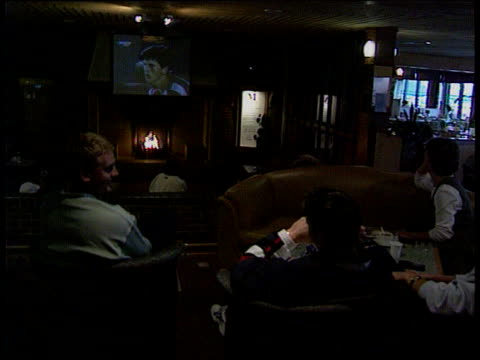 south london david lloyds club people sitting in bar watching tennis on screen vox pops annabel croft intvwd he's learnt so much over the last year - croft stock videos & royalty-free footage