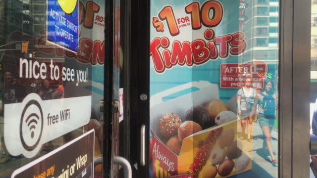 tim horton's door opening and closing in normal day of operations. tim horton's is a successful and popular canadian cafeteria chain. no audio - door chain stock videos & royalty-free footage