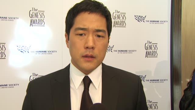 Tim Kang on the event dogs honoree at the 24th Genesis Awards at Beverly Hills CA