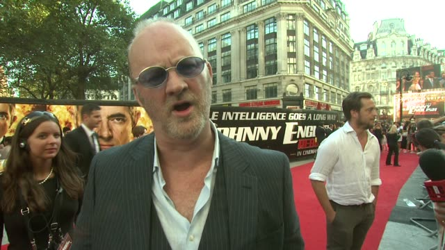 tim mcinnerny on how rowan atkinson is a perfectionist at the johnny english reborn uk premiere at london england. - rowan atkinson stock videos & royalty-free footage