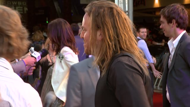 tim minchin at the cowboys aliens uk premiere at london england - cowboys & aliens stock videos and b-roll footage