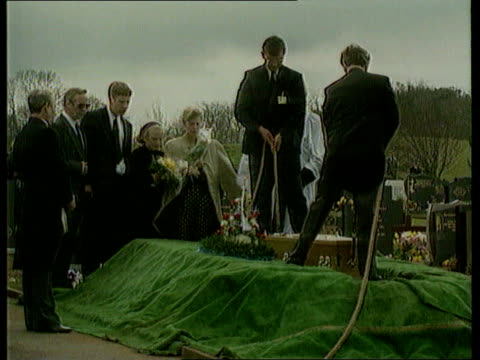 tim parry family hate mail; ext/april 1993 warrington tim's coffin lowered into grave - coffin stock videos & royalty-free footage