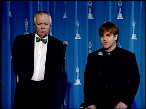 tim rice at the 1995 academy awards at the shrine auditorium in los angeles, california on march 27, 1995. - 1995 bildbanksvideor och videomaterial från bakom kulisserna