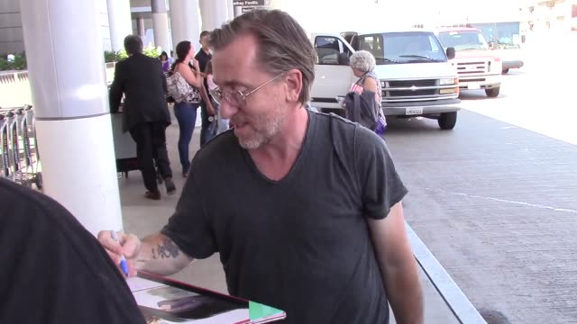tim roth departing at lax airport in los angeles in celebrity sightings in los angeles - tim roth stock videos and b-roll footage