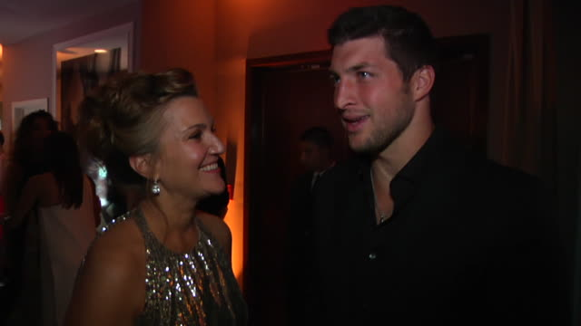 tim tebow at the 2012 vanity fair oscar party hosted by graydon carter - inside party at west hollywood ca. - vanity fair oscar party stock videos & royalty-free footage