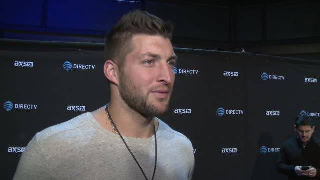 tim tebow on why he wanted to celebrate super bowl with directv, why this is the party of the weekend, why every super bowl experience is different... - game night leisure activity stock videos & royalty-free footage