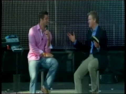 tim tebow takes the stage to give a sermon on easter sunday in texas. - クオーターバック点の映像素材/bロール