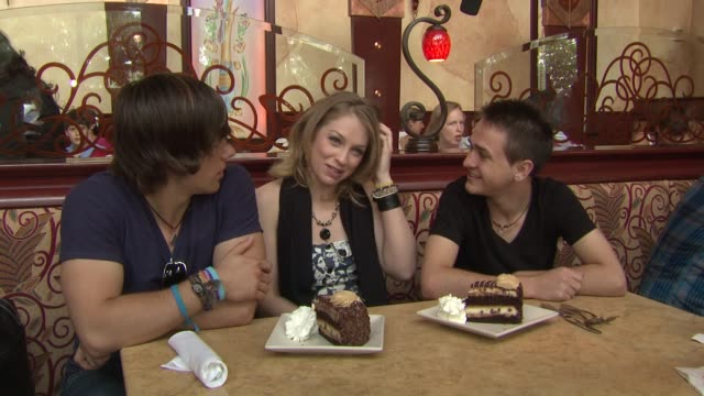 tim urban didi benami aaron kelly on what they thought of reese's peanut butter chocolate cake cheesecake at the american idols celebrate national... - didi benami stock videos and b-roll footage