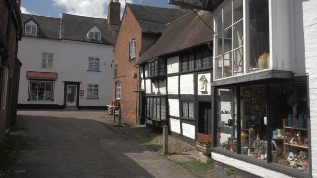 timber clad buildings on narrow street on sunny day in summer, lichfield, staffordshire, england, united kingdom, europe - timber stock videos & royalty-free footage