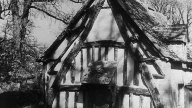 1946 montage timber cottage constructed with wattle and daub / united kingdom - wattle and daub stock videos and b-roll footage