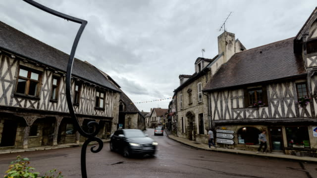 Timbered houses and main street in Vitteaux, a medieval village in Côte-d'Or, Burgundy region, France