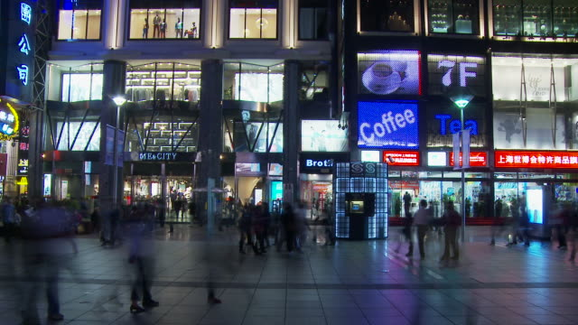 time altered shot of people along nanjing road in shanghai china - nanjing road stock videos & royalty-free footage