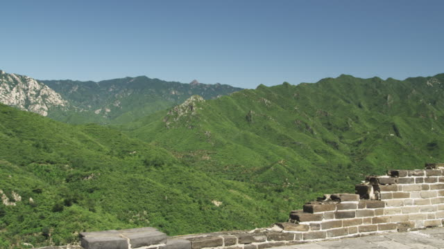 Time and erosion characterize crumbling portions of the Great Wall of China.