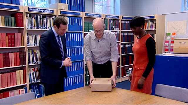 time capsule from 1926 discovered by builders in streatham int jon newman councillor florence nosegbe and reporter looking at contents of time... - lambeth stock-videos und b-roll-filmmaterial