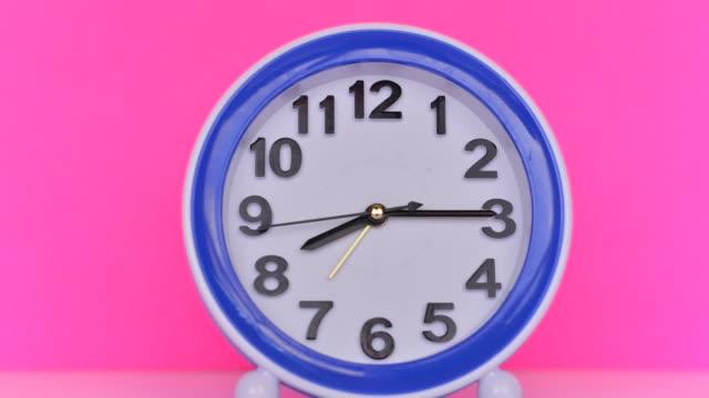 Time flies concept: Alarm clock colorful timelapse