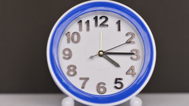 time flies concept: alarm clock colorful timelapse - medium shot stock videos & royalty-free footage