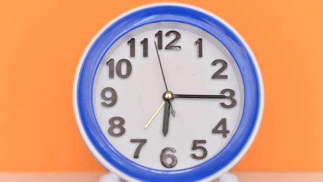 Time flies concept: Alarm clock colorful timelapse