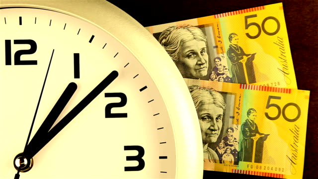 time is money - gold tinted clock and cash - toned image stock videos & royalty-free footage