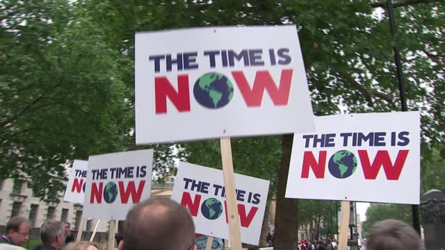 'time is now' environmental protesters march on parliament; england: london: westminster: ext various of 'the time is now' environmental protesters -... - archbishop of canterbury stock videos & royalty-free footage