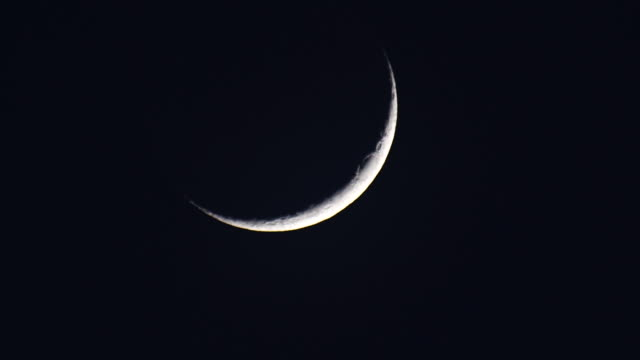 time lape of the crescent moon passing throught the dark night sky - 1 minute or greater stock videos & royalty-free footage