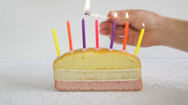 time laps of 7 candles being lit on birthday cake - birthday stock videos & royalty-free footage